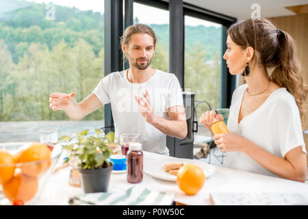 Couple having a breakfast at home - Stock Photo