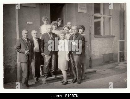 THE CZECHOSLOVAK SOCIALIST REPUBLIC, CIRCA 1970s: Vintage photo shows group of people in front of building. - Stock Photo