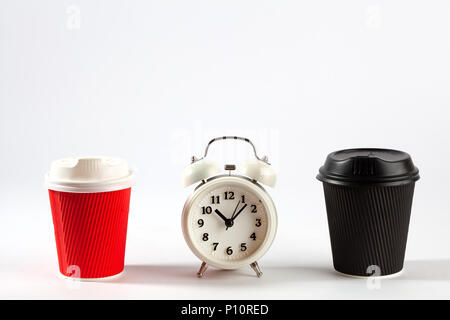 Coffee time concept - two disposable coffee cups and retro alarm clock on white background with copy space - Stock Photo