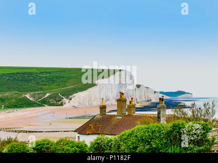 coastguard cottages at seaford head with a view of the seven sisters cliffs in the background - Stock Photo