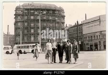 GERMANY - CIRCA 1960s: Vintage photo shows group of people in unknown town in Germany (GDR). - Stock Photo
