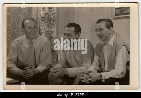 THE CZECHOSLOVAK SOCIALIST REPUBLIC - 1960s: Vintage photo shows men have a pleasant time at home. - Stock Photo