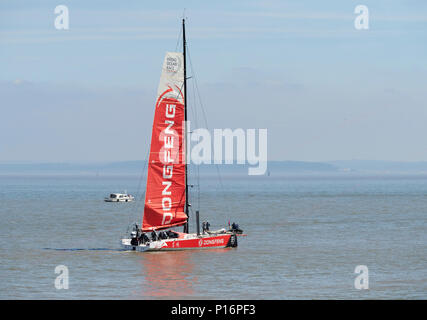 Cardiff Bay, Cardiff, Wales UK. 10th June 2018. Current race leader Dongfeng Race Team hoist their sail as they  leave port to prepare for the start of The Volvo Ocean Race  Leg 10 Cardiff to Gothenburg. Credit: Phillip Thomas/Alamy Live News - Stock Photo