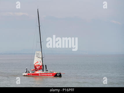 Cardiff Bay, Cardiff, Wales UK. 10th June 2018. Current race leader Dongfeng Race Team,  leaves port to prepare for the start of The Volvo Ocean Race  Leg 10 Cardiff to Gothenburg. Credit: Phillip Thomas/Alamy Live News - Stock Photo