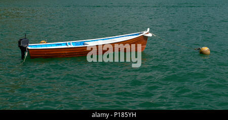 a small wooden boat on the lake - Stock Photo