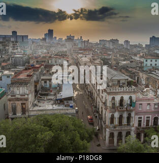 Sunset in Havana over the city looking down a long quiet street - Stock Photo