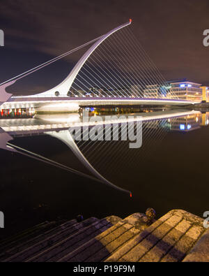Dublin, Ireland - September 17, 2016: The cable-stayed Samuel Beckett Bridge, designed to invoke the Irish Harp, crossing the River Liffey in Dublin's - Stock Photo