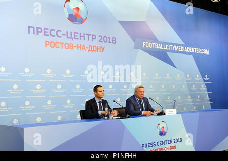 Rostov On Don, Russia. 13th June, 2018. ROSTOV-ON-DON, RUSSIA - JUNE 13, 2018: Rostov-on-Don Region Governor Vasily Golubev (R) at the opening of the 2018 FIFA World Cup press office. Maxim Romanov/TASS Credit: ITAR-TASS News Agency/Alamy Live News - Stock Photo