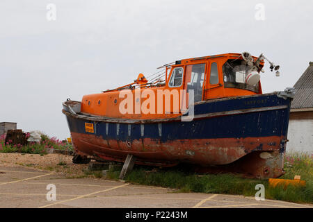 Old Lifeboat on beach - Stock Photo