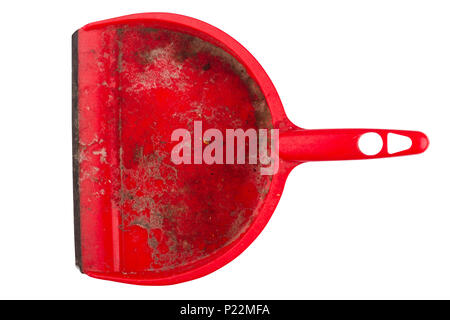 top view closeup of red plastic dirty dustpan isolated on white background - Stock Photo