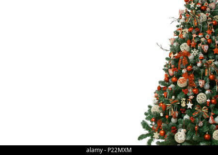 Half of christmas tree isolated on white background, decorated with vintage ornaments, wooden snowflakes, red berries and balls,red white jingle bells - Stock Photo