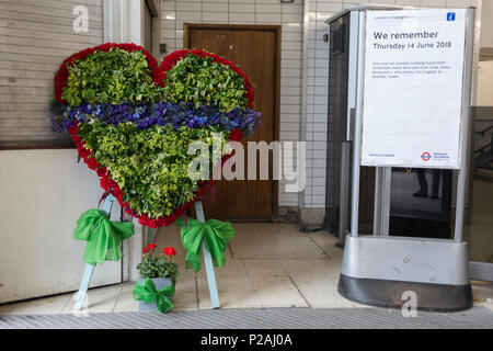 London, UK. 14th Jun, 2018.  A memorial wreath at the entrance of Latimer Road tube station on the first anniversary of the Grenfell tower fire. 72 people died when the tower block in the borough of Kensington & Chelsea were killed in what has been called the largest fire since WW2. The 24-storey Grenfell Tower block of public housing flats in North Kensington, West London, United Kingdom. It caused 72 deaths, out of the 293 people in the building, including 2 who escaped and died in hospital. Over 70 were injured and left traumatised. Credit: RichardBaker/Alamy Live News - Stock Photo
