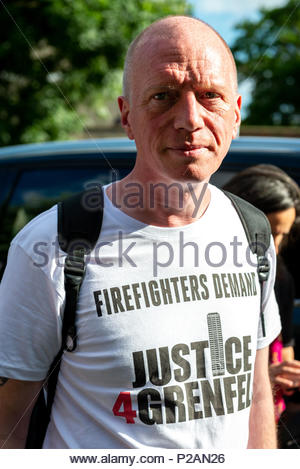London, Great Britain, 14 Jun 2018 On the first anniversary of the Grenfell Tower tragedy, people gather for a silent procession and vigil in memory of those that died and call for justice. Matt Wrack, General Secretary of the Fire Brigades Union.  Credit: David Nash/Alamy Live News - Stock Photo