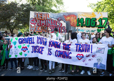 London, UK. 14th June, 2018. Members of the Grenfell community and supporters take part in the Grenfell Silent March through West Kensington on the first anniversary of the Grenfell Tower fire. 72 people died in the Grenfell Tower fire and over 70 were injured. Credit: Mark Kerrison/Alamy Live News - Stock Photo