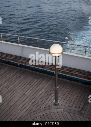 lamp post on a ferry deck at sunset - Stock Photo
