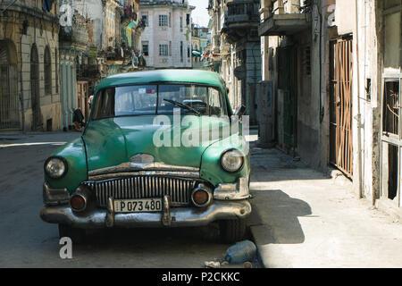 A mint green oldtimer in Havanna, Cuba - Stock Photo