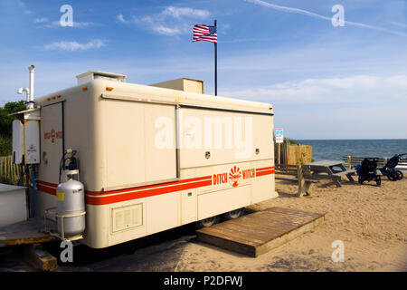 MONTAUK, NEW YORK-JUNE 8: The Ditch With food stand on wheels is shown closed in off season in parking lot of famed surfing beach Ditch Plains in Mont - Stock Photo
