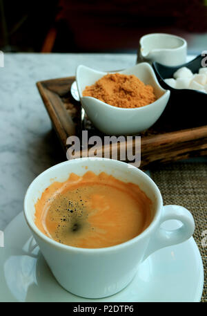 One Cup of Hot Americano Served on the Table with a Coffee Condiment Set - Stock Photo