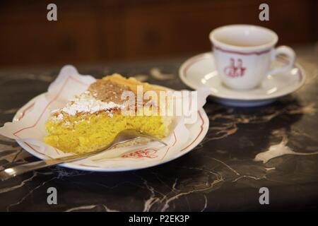 Italy, Liguria, Genes, almond cake and coffee in the counter of the historical bakery Marescotti di Cavo - Stock Photo