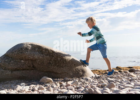 Boy playing on the beach, 5 years old, Baltic sea, MR, Bornholm, near Gudhjem, Denmark, Europe - Stock Photo