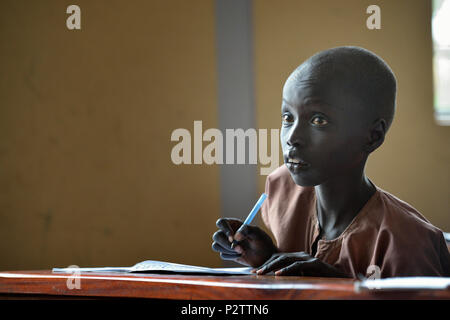 A student in the Loreto Primary School in Rumbek, South Sudan - Stock Photo