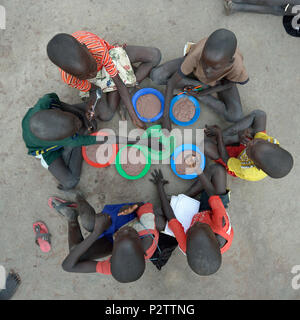Children enjoy lunch in the Loreto Primary School in Rumbek, South Sudan. - Stock Photo