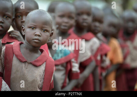 Students line up during an assembly at the beginning of the day in the Loreto Primary School in Rumbek, South Sudan. - Stock Photo