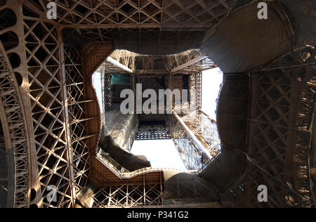 Looking up through the bottom of the Eiffel Tower, Paris, France, Europe - Stock Photo