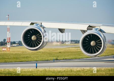 Engines of the huge airplane on the airport runway. - Stock Photo