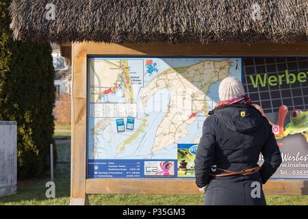 Breege, Germany, tourist in front of an information board on Ruegen - Stock Photo