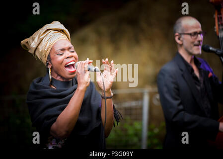 The Grace Notes performing at Trebah Garden amphitheatre in Cornwall. - Stock Photo