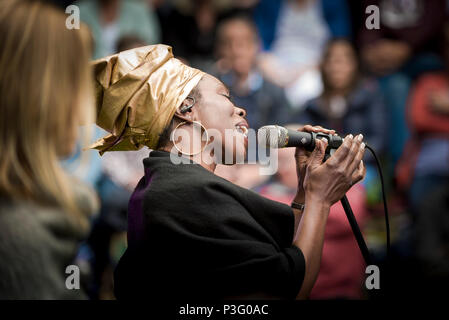 Ley Adewole lead singer of The Grace Notes performing at Trebah Garden amphitheatre in Cornwall. - Stock Photo