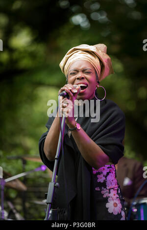 Ley Adewole lead vocalist with the The Grace Notes performing at Trebah Garden amphitheatre in Cornwall. - Stock Photo