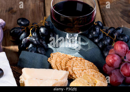 A glass of red wine and a snack. copy space. - Stock Photo