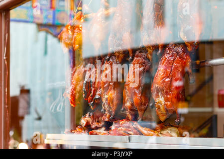 Rows of roast ducks on display at a Chinese restaurant in London Chinatown - Stock Photo