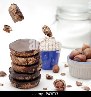 Homemade oatmeal protein cookies with raisins,dates and peanuts. - Stock Photo