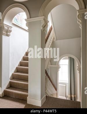 Elegant Victorian arches in stairway - Stock Photo