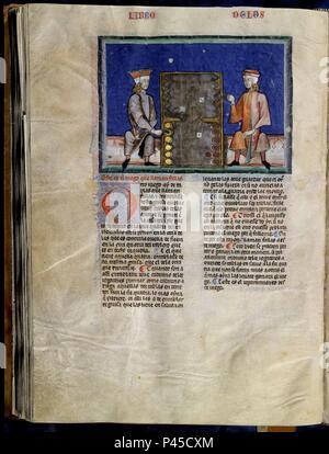LIBRO DE JUEGOS O LIBRO DEL AJEDREZ DADOS Y TABLAS - 1283 - FOLIO 74V - JUEGO DEL DOBLET - MANUSCRITO GOTICO. Author: Alfonso X of Castile the Wise (1221-1284). Location: MONASTERIO-BIBLIOTECA-COLECCION, SAN LORENZO DEL ESCORIAL, MADRID, SPAIN. - Stock Photo