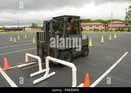 Ohio Air National Guard Senior Airman James Weese, 178th Logistics Readiness Squadron, operates a forklift June 7, 2016, at Alpena Combat Readiness Training Center, Alpena Michigan.  Weese operated the forklift as part of a material handling equipment refresher class during the 178th wing annual training. (Ohio Air National Guard Photo by Master Sgt. Seth Skidmore) - Stock Photo