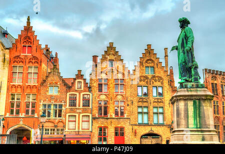 Statue of Jan van Eyck, an Early Netherlandish painter in Bruges, Belgium - Stock Photo