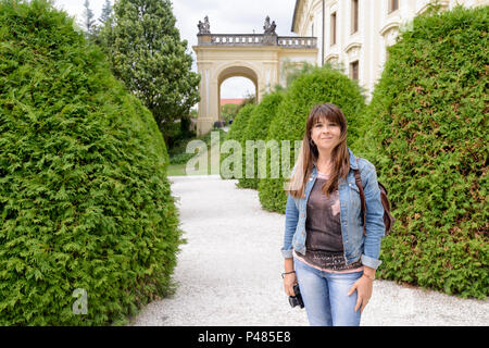 A tourists girl in the Prague Castle complex - Stock Photo