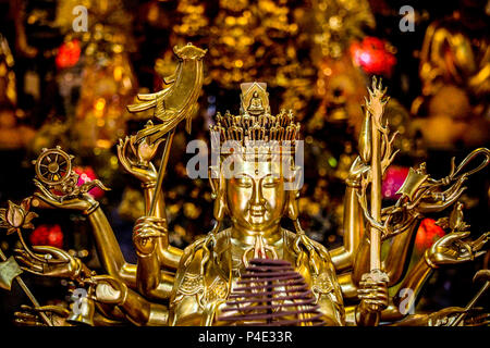 Hanoi, Vietnam - March 15, 2018: Detail of a golden Buddha statue at the interior of the One Pillar Pagoda, one of Hanoi's landmarks - Stock Photo