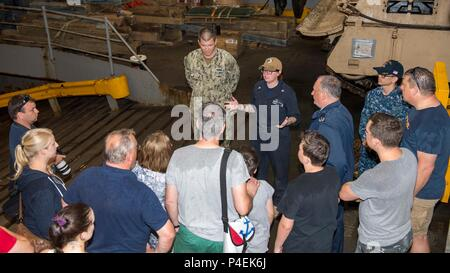 180616-N-PC620-0030  KIEL, Germany (June 16, 2018) Boatswain's Mate 2nd Class Brooke Bagatta, from Liberty, New York, gives a tour of the Harpers Ferry-class dock landing ship USS Oak Hill (LSD 51) in Kiel, Germany, during Kiel Week 2018, June 16. Oak Hill, home-ported in Virginia Beach, Virginia, is conducting naval operations in the U.S. 6th Fleet area of operations. (U.S. Navy photo by Mass Communication Specialist 3rd Class Michael H. Lehman/Released) - Stock Photo