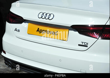 Yellow Approved car plate on an Audi at a dealership in the uk - Stock Photo