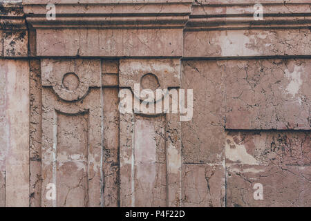 close-up shot of cracked wall with ancient decor elements for background - Stock Photo