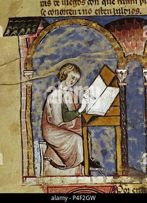 LIBRO DE JUEGOS O LIBRO DEL AJEDREZ DADOS Y TABLAS - 1283 - FOLIO 1V - DETALLE - ESCRIBA DEL ESCRITORIO REAL PREPARANDO EL PERGAMINO - Conj nº 90001. Author: Alfonso X of Castile the Wise (1221-1284). Location: MONASTERIO-BIBLIOTECA-COLECCION, SAN LORENZO DEL ESCORIAL, MADRID, SPAIN. - Stock Photo