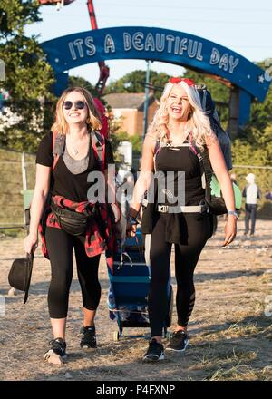 Ami Greenwell and Alison Kydd from London arrive on site at the Isle of Wight festival at Seaclose Park, Newport. - Stock Photo