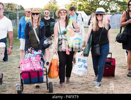 Kelly Connolly, Ley Tresadern, and Jayne Newman from London arrive on site at the Isle of Wight festival at Seaclose Park, Newport. - Stock Photo