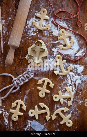 Anchor-shaped ginger butter cookies (unbaked) - Stock Photo