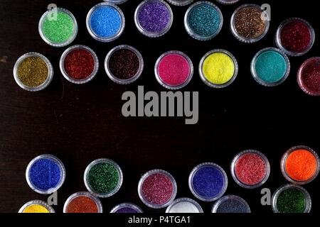 Photo of assorted colorful nail polish glitters - Stock Photo